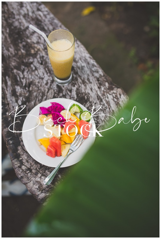 Healthy breakfast in the jungle, fruit salad and juice.