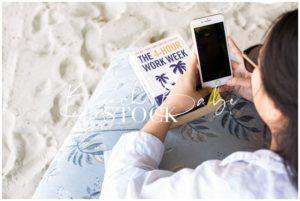 Female Entrepreneur Using Phone on the Beach