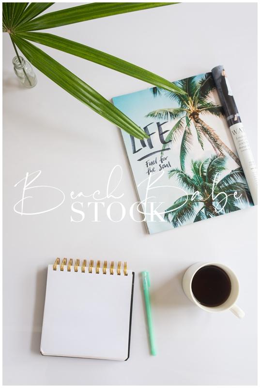 Tropical Styled Flatlay with Palm, Magazine and Coffee